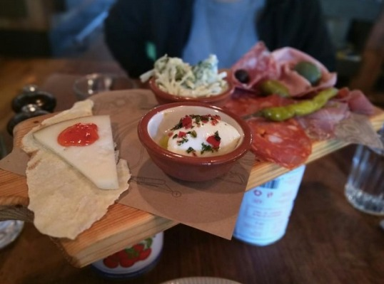 Cured Meats - Fennel salami, pistachio mortadella, prosciutto & schiacciata piccante served with mini buffalo mozzarella, pecorino & chilli jam, a selection of pickles, olives & crunchy vegetable slaw